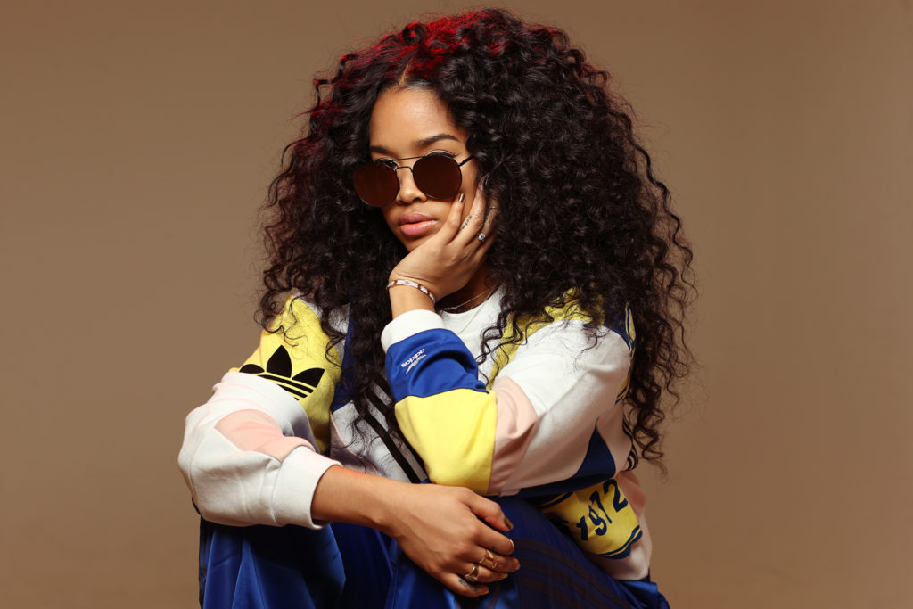 Grammy Award-Winner H.E.R. Spills Her Coveted Beauty Tips (And Reveals The Best Face Mask For Eyeglass Wearers)