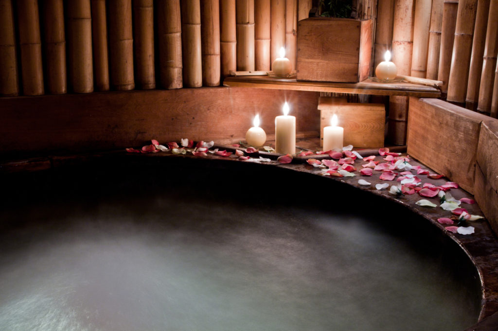 Romantic spa - hot tub tub with rose petals